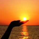 hand in sunrise