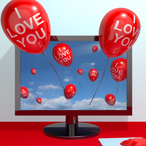 I Love You Balloons From Computer Screen Showing Love And Online Dating